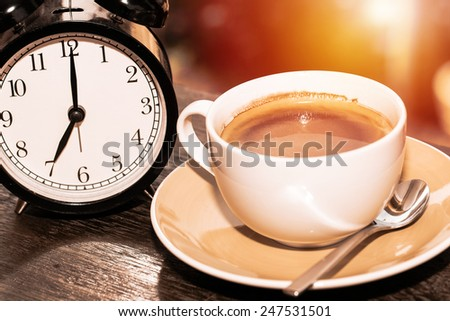 Alarm clock with coffee. coffee time concept - stock photo