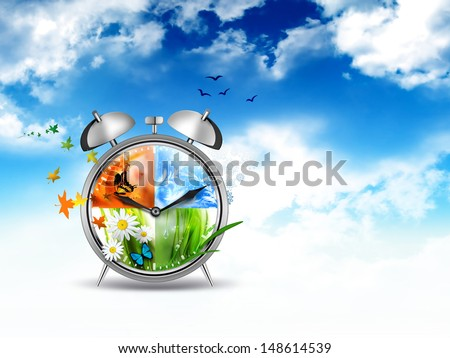 alarm clock with Four Seasons - time concept image - stock photo