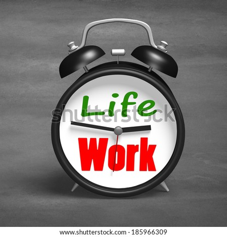 Alarm clock with life and work face on concrete ground - stock photo