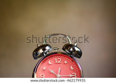alarm clock with old  background . Vintage tone
