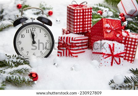Alarm clock with snow and Christmas decorations  - stock photo