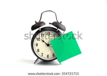 Alarm clock with sticky paper - stock photo