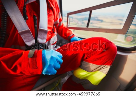 Alarm for the air rescue service. Doctor is preparing in the helicopter emergency medical service. - selective focus on the glove