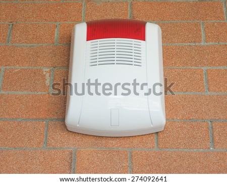 Alarm siren and flash light against burglary - stock photo