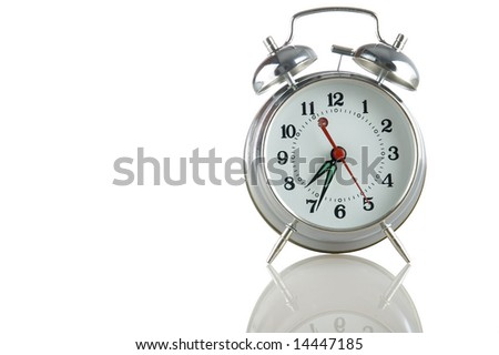 alarmclock with reflection on a white background
