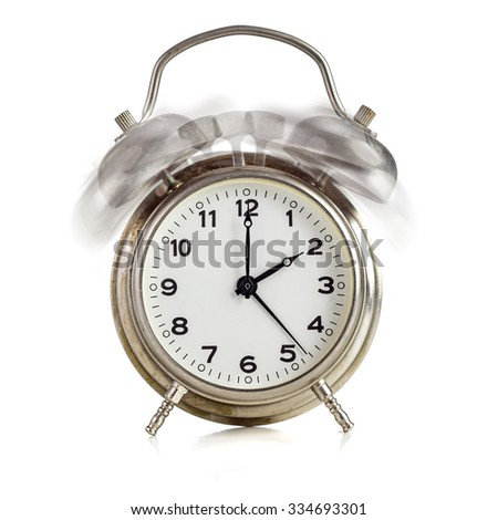 Alarming old dirty vintage metal clock showing twelve o'clock over white background - stock photo