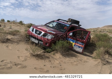 ALASHAN, CHINA-JULY 22, 2016: Press car gets over the difficult part of the route during the  Silk Way rally Moscow-Beijing Dakar series in the Badain Jaran desert