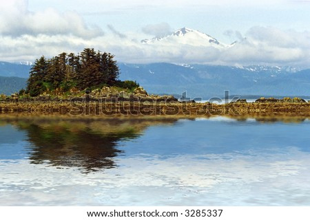 alaska inland passage waterway and islands with mountains in background