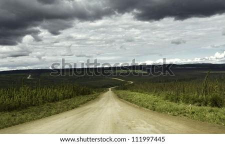 Alaska, raw gravel road to Arctic Circle - stock photo
