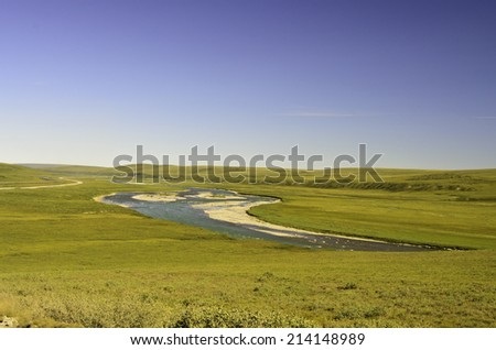 Alaska stream and oil pipeline - stock photo
