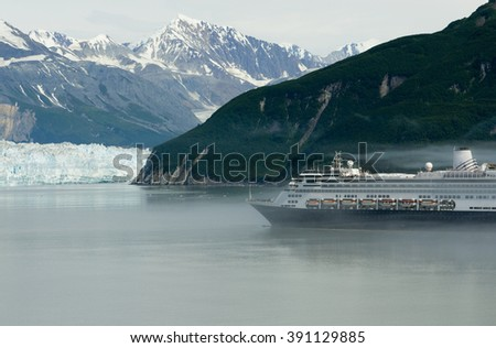 Alaskan cruise ship destination vacation with ice glacier background - stock photo