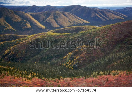Alaskan landscape with rolling hills and mountains.