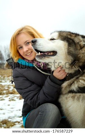 Alaskan Malamutes and girl on a walk