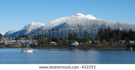 Alaskan mountain shining with new snow in afternoon sun - stock photo