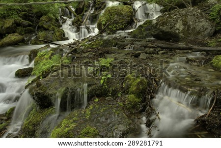 Alaskan Summer Waterfall - stock photo