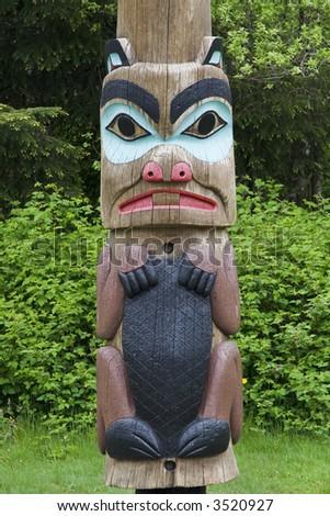 Alaskan totem pole of Saxman Nature Village in Ketchikan Alaska - stock photo