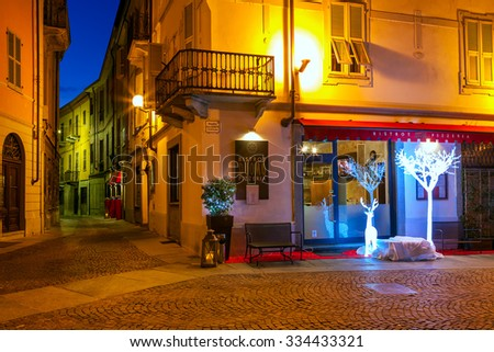 ALBA, ITALY - DECEMBER 06, 2012: Small restaurant decorated for Christmas in Alba - town in Piedmont, capital of hilly area of Langhe, is famous for white truffle, peach and wine production. - stock photo