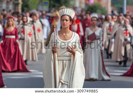 ALBA, ITALY - OCTOBER 05, 2014: Participant in historic dress on Medieval Parade - traditional part of annual White Truffle festival and celebrations taking place each year on October in Alba, Italy. - stock photo