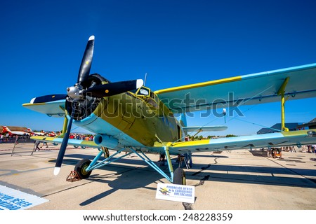 ALBACETE, SPAIN-JUN 23:  Aircraft Antonov An-2 taking part in a static exhibition on the open day of the airbase of Los Llanos on Jun 23, 2013, in Albacete, Spain - stock photo