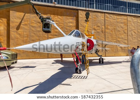 ALBACETE, SPAIN-JUN 23: Aircraft Dassault Mirage F1 taking part in a static  exhibition on the open day of the airbase of Los Llanos on Jun 23, 2013, in Albacete, Spain
