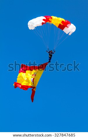ALBACETE, SPAIN-JUN 23:  Parachutist of the PAPEA taking part in an exhibition on the open day of the airbase of Los Llanos on Jun 23, 2013, in Albacete, Spain - stock photo