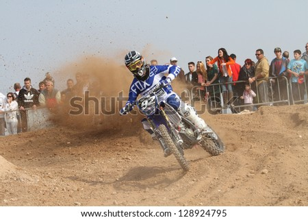 ALBAIDA, SPAIN - FEBRUARY 17:An unidentified rider of motorcycling in the Spanish championship of motocross on February 17, 2013, Albaida, Spain