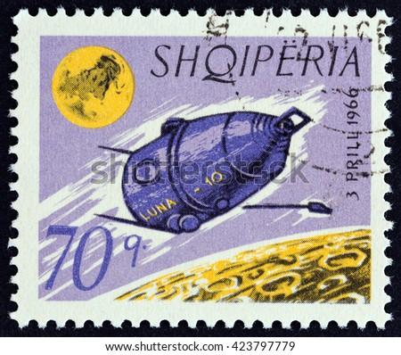 "ALBANIA - CIRCA 1966: A stamp printed in Albania from the ""Luna 10 "" issue shows Luna 10, circa 1966. - stock photo"