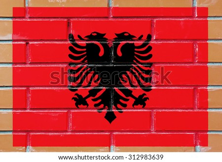 Albania flag painted on old brick wall texture background - stock photo