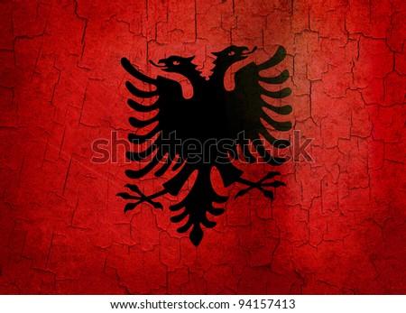 Albanian flag on a cracked grunge background - stock photo