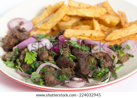 Albanian Liver, a traditional Turkish spiced lamb's liver recipe popular throughout the Middle East, with french fried chips - stock photo