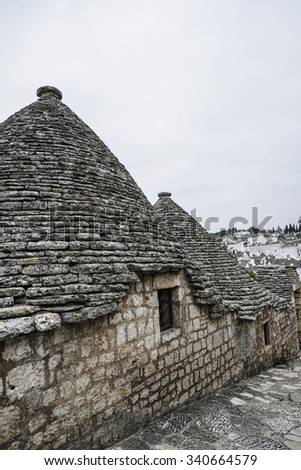 ALBEROBELLO, ITALY - NOVEMBER 14, 2015: Trulli houses in Alberobello where is UNESCO World Heritage Site highly popular among tourists in Apulia, Italy.