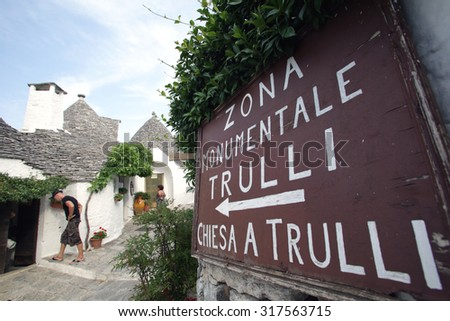 ALBEROBELLO, ITALY - THURSDAY, JULY 23, 2015:  Exterior views of Trullo homes  in Alberobello. A trullo is a traditional hut with a conical roof.  Photographer: Mark Milstein/ Northfoto - stock photo