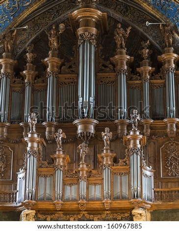 ALBI, FRANCE - JULY 8, 2013: Organ of the Sainte-Cecile cathedral in Albi, on July 8, 2013. This medieval church, in gothic style, is a catholic place of worship open to visits.