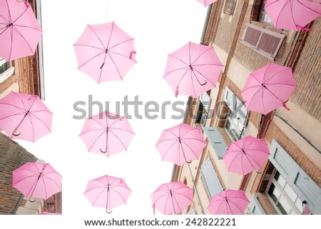 ALBI FRANCE - OCTOBER 7, 2014:  Pretty pink umbrellas in Albi for Breast Cancer Awareness Month on October 7, 2014 in Albi, Tarn, France. - stock photo