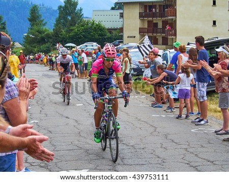 ALBIEZ-MONTROND, FRANCE - JULY 24, 2015: Bicycle riders from Lampre and Trek going to the top at Col du Mollard  - stock photo