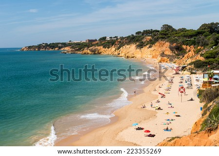 ALBUFEIRA, PORTUGAL - OCTOBER 4, 2014: Olhos de agua beach in Albufeira. This beach is a part of famous tourist region Algarve.