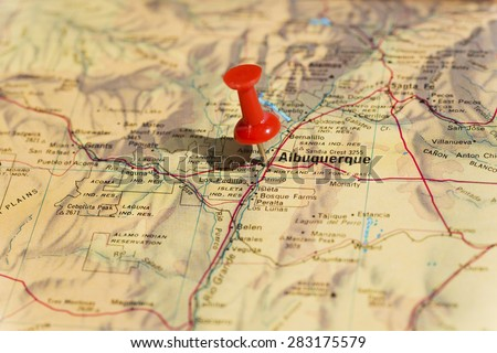 Albuquerque marked on map with red pushpin. Selective focus on the word Albuquerque and the bottom of pushpin. Pin is in an angle and casts shadow to the left. - stock photo