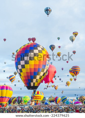 ALBUQUERQUE, NEW MEXICO - OCT 11: Balloons fly over Albuquerque on October 11, 2014 in Albuquerque, New Mexico. Albuquerque balloon fiesta is the biggest balloon event in the world.