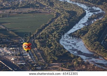 ALBUQUERQUE, NEW MEXICO - OCTOBER 9: Balloon flies over Albuquerque on October 9, 2010 in Albuquerque, New Mexico. Albuquerque balloon fiesta is the biggest balloon event in the the world. - stock photo