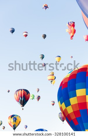 ALBUQUERQUE, NEW MEXICO - OCTOBER 6, 2015: Balloons fly over Albuquerque, New Mexico. International balloon fiesta is the biggest hot air balloon event in the world. - stock photo