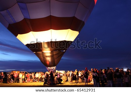 ALBUQUERQUE, NEW MEXICO - OCTOBER 9: Balloons glow during the morning glow event on October 9, 2010 in Albuquerque, New Mexico.Albuquerque balloon fiesta is the biggest balloon event in the the world. - stock photo