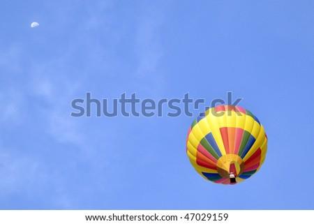 ALBUQUERQUE,  NM - OCTOBER 10: A hot air balloon soars at Albuquerque International Hot Air Balloon Fiesta October 10, 2009 in Albuquerque, NM. - stock photo