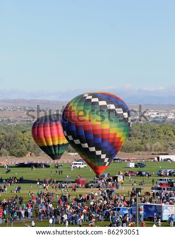 ALBUQUERQUE, NM - OCTOBER 8: Crowds cheer hot air balloon flight crews during the annual International Balloon Fiesta in Albuquerque, NM on October 8, 2011 - stock photo