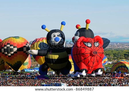 ALBUQUERQUE, NM - OCTOBER 8: Crowds cheer hot air balloon flight crews during the annual International Balloon Fiesta in Albuquerque, NM on October 8, 2011.