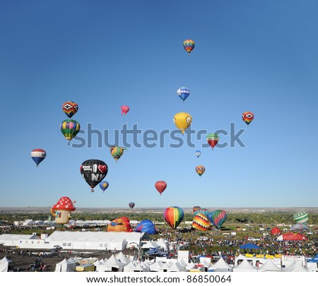 ALBUQUERQUE, NM - OCTOBER 8: Crowds cheer hot air balloon flight crews during the annual International Balloon Fiesta in Albuquerque, NM on October 8, 2011. - stock photo