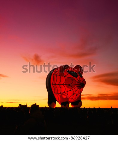 ALBUQUERQUE, NM - OCTOBER 8:: Crowds gather for the how air balloon night glow exhibition at the annual International Balloon Fiesta in Albuquerque, New Mexico on Oct 8, 2011 - stock photo