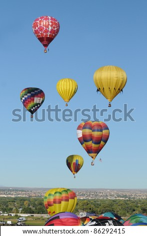 ALBUQUERQUE, NM - OCTOBER 8: Mass hot air balloon ascend during the annual International Balloon Fiesta in Albuquerque, NM on October 8, 2011 - stock photo