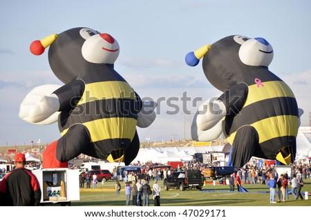 ALBUQUERQUE,  NM - OCTOBER 8: Two bumble bee shape hot air balloons soar at Albuquerque International Hot Air Balloon Fiesta October 8, 2009 in Albuquerque, NM. - stock photo