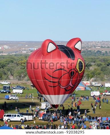 ALBUQUERQUE - NOVEMBER 8: Crowds cheer hot air balloon at the annual International Balloon Fiesta. The event took place on November 8, 2011 in Albuquerque, New Mexico, USA - stock photo