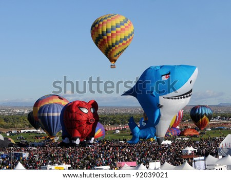 ALBUQUERQUE - NOVEMBER 8: Crowds cheer hot air balloons at the annual International Balloon Fiesta. The event took place on Nov 8, 2011 in Albuquerque, New Mexico. - stock photo